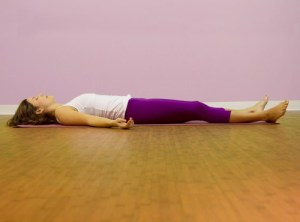 A woman in corpse pose or 'savasana'