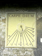A sundial inscribed with Carpe Diem, reminding us that every moment is precious and not to be taken advantage